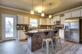 Kichler Kitchen Lighting Kitchen With Simple Granite Counters U0026 Raised Panel In Wyoming Mi