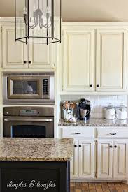 Colorful Kitchen Backsplashes Cream Colored Cabinets White Subway Tile Backsplash Island