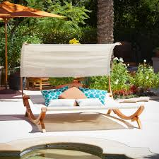 right in your own backyard the marrakech sunbed with canopy is a perfect relaxation getaway