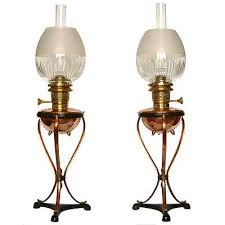 pair of arts u0026 crafts brass and copper oil lamps by w a s benson