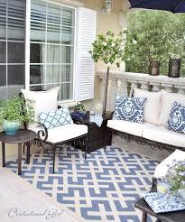 use an outdoor rug to anchor backyard furniture home pinterest