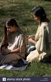 free mative american braids for hair photos a native american indian woman braiding the hair of a young girl
