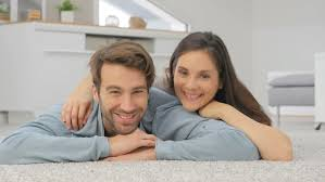 Carpet In Living Room couple laying on carpet in living room stock footage video