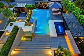 modern custom outdoor boulder waterfall and swimming pool fire pit