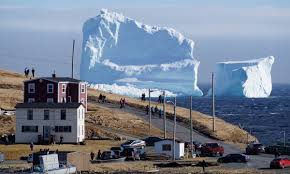 massive north atlantic iceberg draws photographers and tourists to