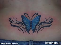 cute butterfly tattoo on lower back