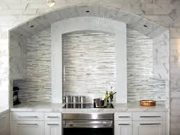 cool kitchen backsplash ideas like the colors in this back splash with cabinets and light