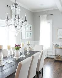 lovely charcoal gray dining room with acrylic chairs and wooden