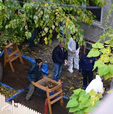 cops to look for body in brooklyn backyard after dogs catch scent
