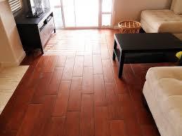 medium floor tiles intended to look like wooden boards