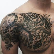black ink tiger on right shoulder and chest