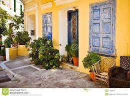 ornamental blue doors plants and windows samos greece stock