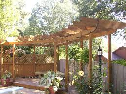 Potted Plant Ideas For Patio by Exterior Small Curved Wooden Pergola Design For Corner Space