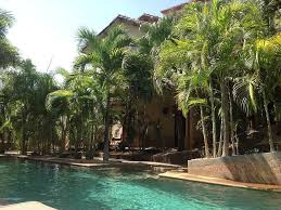 2 story house in gated community with pool and sandy beach