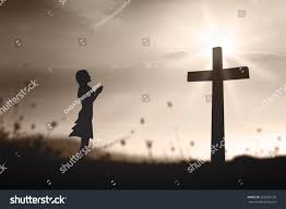 Amazing Light by Silhouette Woman Praying Over Cross On Stock Photo 262285139