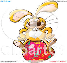 cartoon of a happy easter bunny sitting on an egg royalty free