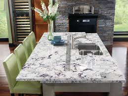 image result for cream cabinets grey glass backsplash island cambria praa sands kitchen island accented with cool green tones