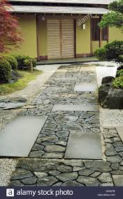 stone way to the house in traditional japanese zen garden stock