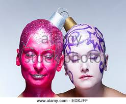 two with fantastic makeup posing as ornaments