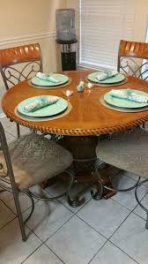 round ashley furniture oak table with claw feet and ornate metal