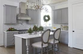 small kitchen island with gray beaded chandeliers transitional