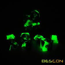 glow in the dark rocks bescon two tone glow in the dark polyhedral dice set spooky rocks