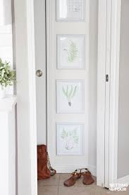 gallery wall of botanical prints setting for four