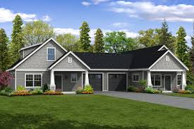 this charming cottage duplex plan has two unique units unit a is