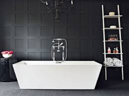 textured accent wall black and white bathroom wall paneling