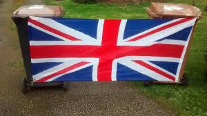 uk councillor flies union jack flag tied to two wheelie bins to