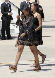 michelle obama and her daughters malia and sasha step out in