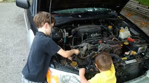 baja subaru wrx teaching my oldest how to change spark plugs on my baja subaru