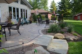 How To Lay A Patio With Pavers by 4 Reasons To Replace Your Wooden Deck With A Paver Patio