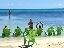 the season for sun worshiping on ambergris caye is near and a