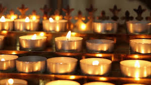lighted candles on table in catholic church lots of candles with