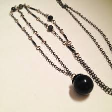 crystal ball necklace images The magician golden obsidian black garnet gemstone dark crystal png