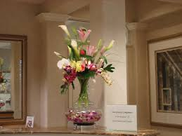 large mixed arrangement with calla lilies and orchids floral