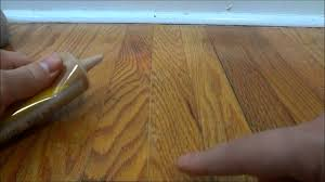 Laminate Flooring Youtube How To Fill In Gaps Between Hardwood Flooring With Wood Filler