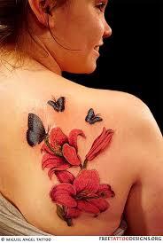 22 hibiscus tattoos on back shoulder
