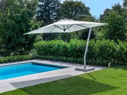 Solar Patio Umbrella White Rectangle Patio Umbrella With Solar Lights Aside Blue Lap