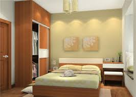 small modern bedroom design featuring brown cherry wood platform