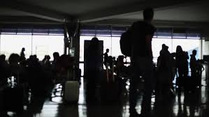 people in hall of airport shade on floor stock footage video
