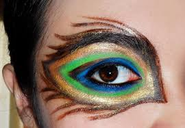 avant garde looks peacock feather inspired mask glitteredblood