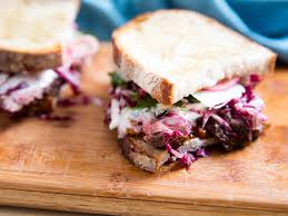 steak sandwiches with roasted tomatoes parmesan and radicchio