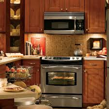 simple subway tile backsplash with modern stove and oven also anne