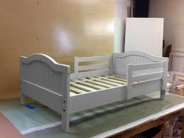 How To Change A Crib Into A Toddler Bed by How To Give A Basic Toddler Bed A Designer Look Hgtv