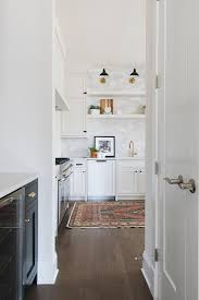 white kitchen cabinets with oak floors brown oak floors with white shaker cabinets transitional