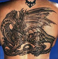 tattoo back face back tattoo of magical pretty dragon with scary face near it