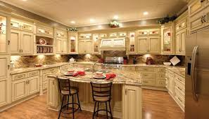 honey oak kitchen cabinets with stainless steel appliances