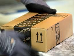 amazon warehouse black friday why amazon pays employees 5 000 to quit cbs news
